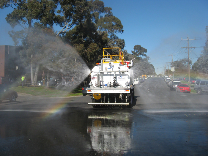 Magnumaustralia Gallery Magnumtruck Being Driven On Road With Water Dispersal From Rear